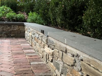Dry Laid Brick Patio with Stone Seat Wall