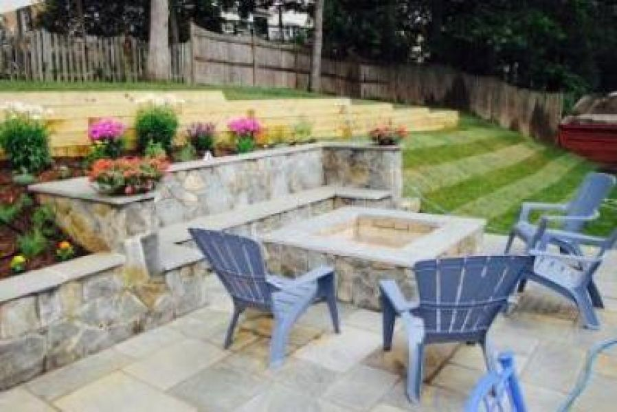 Dimensional flagstone patio with Maryland blend stone walls and fire pit & Outdoor Patio Designs u0026 Installation | Ju0026J Landscape Management Inc.